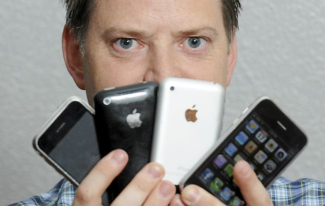 Man looking at apple iPhones